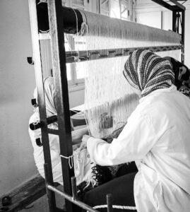 Berber woman making rug