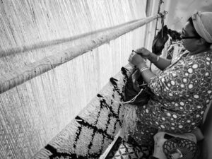 Berber woman making carpet